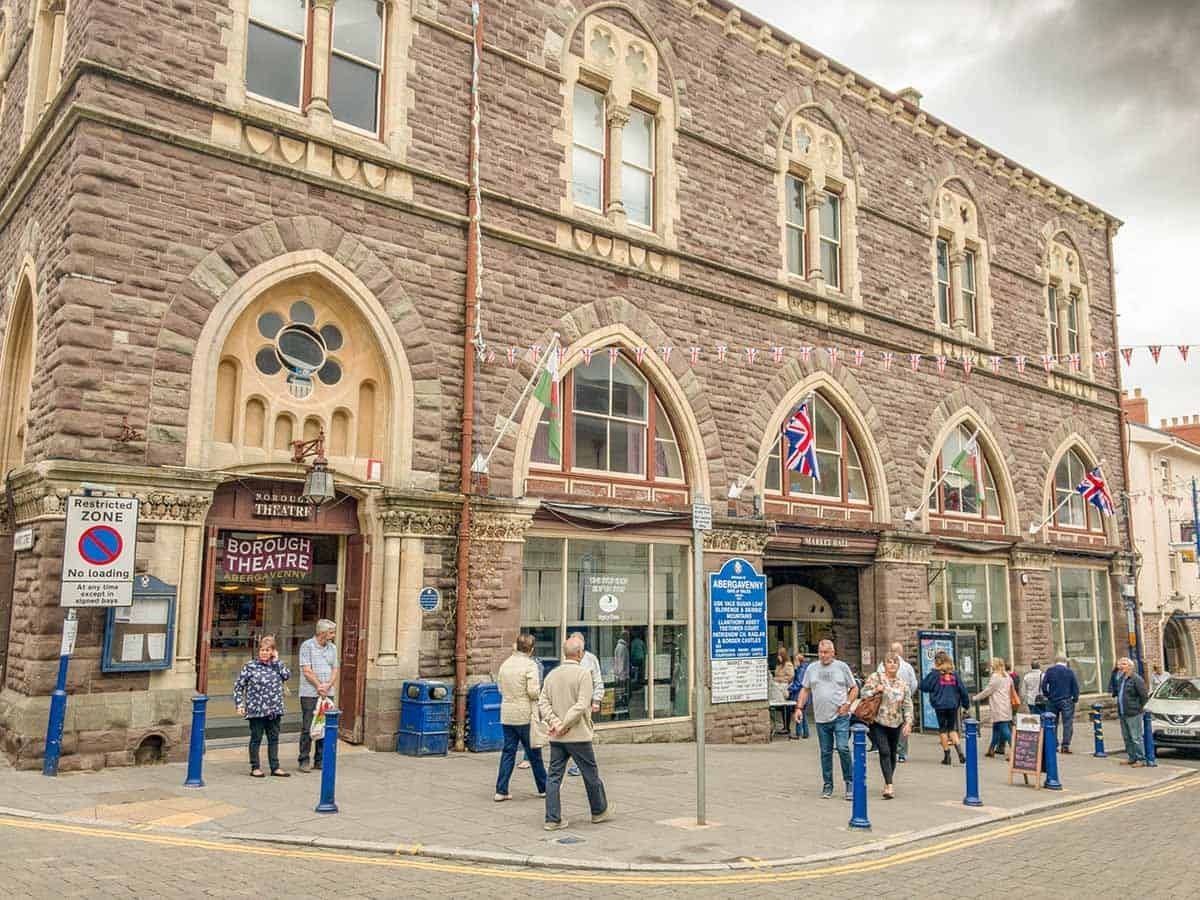 Wide angle view of the exterior of the market hall building in Abergavenny town centre in Wales