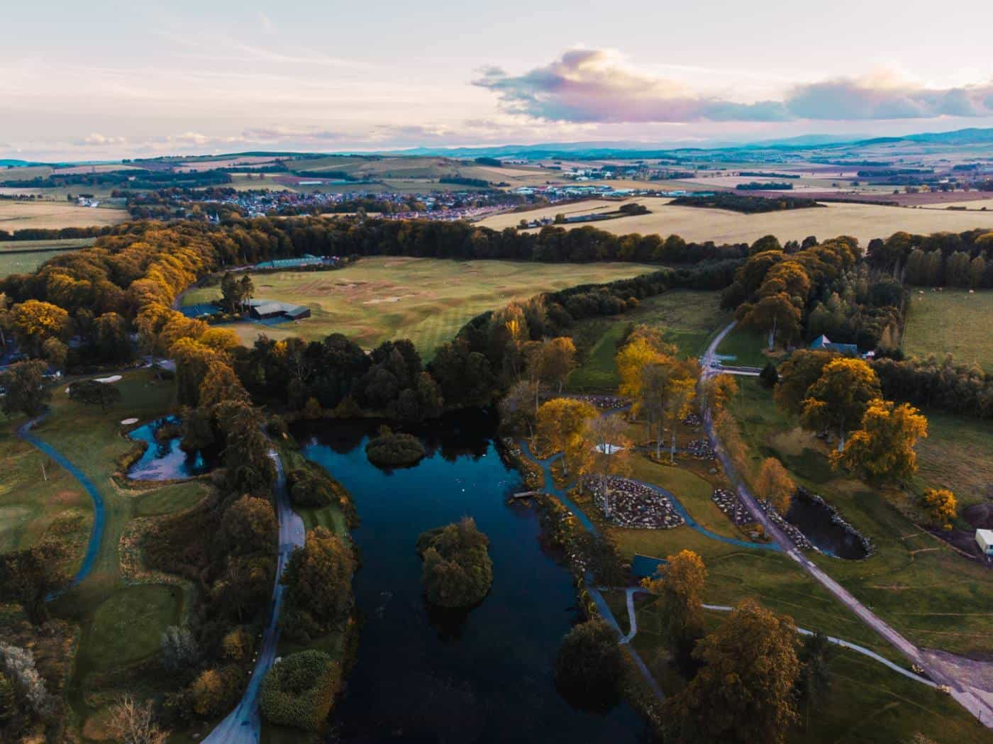Aerial view of a river and green hills at Banchory Lodge in Aberdeenshire