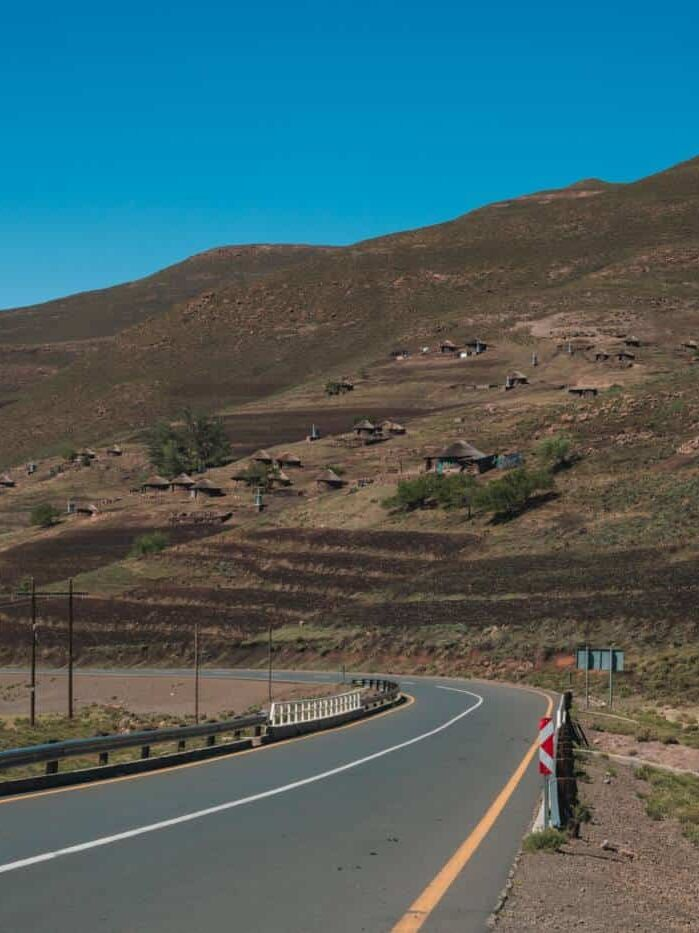 A main road in Lesotho with a mountain in the background