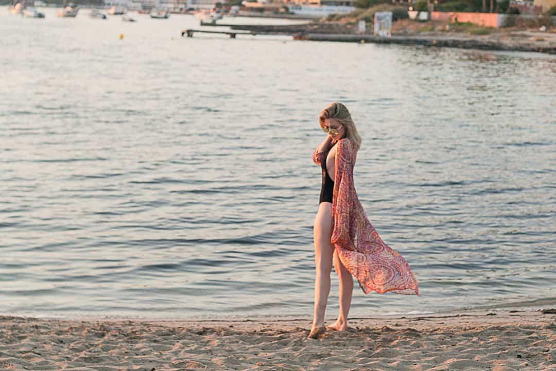 Woman wearing swimsuit and tunic in Ibiza