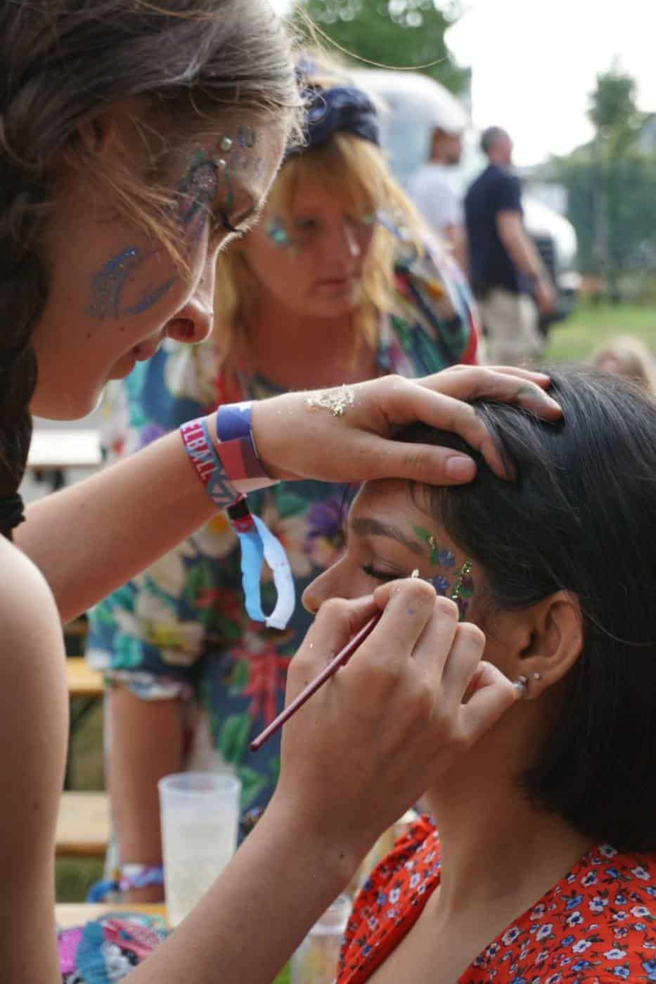 Makeup and feathers at Vogelball Hamburg festival