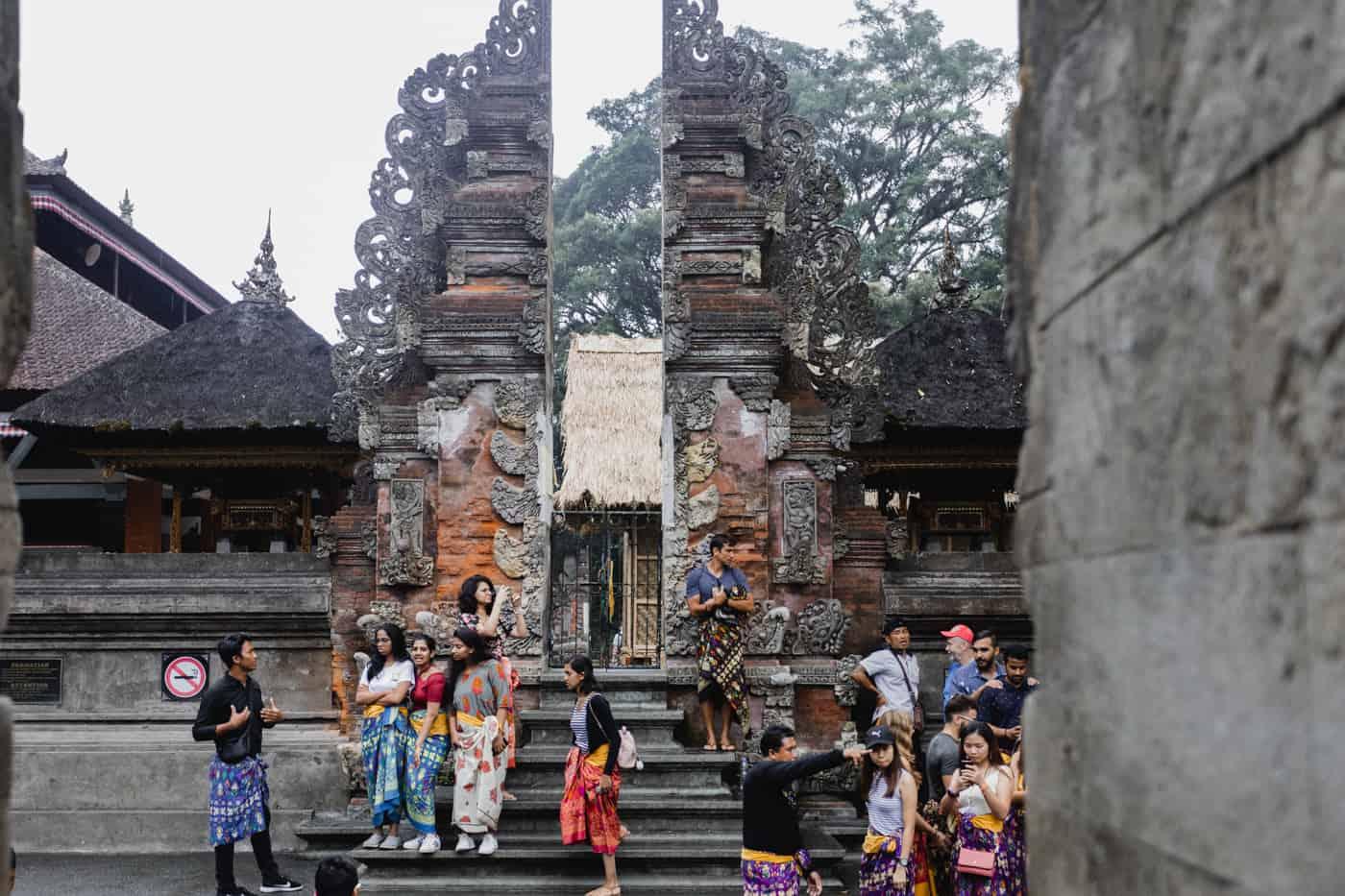 People wearing sarongs at Tirta Empul Temple in Bali
