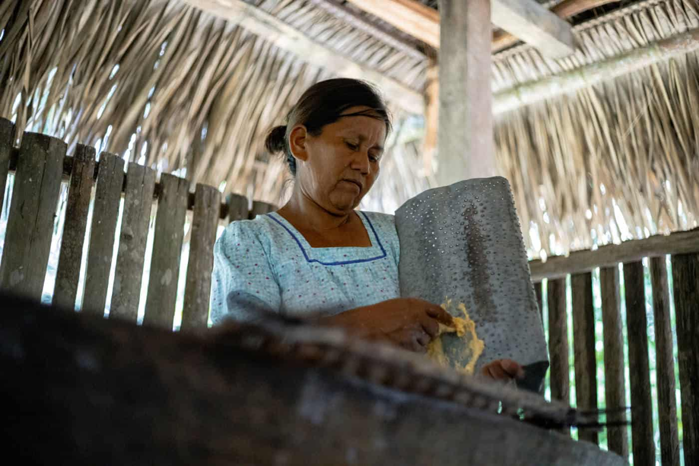 A Kichwa woman making kassava bread in an Amazon community
