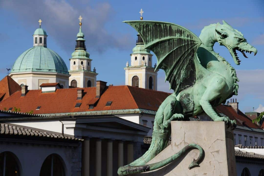 Dragon statue and red roofs in Old Town Ljubljana in Slovenia