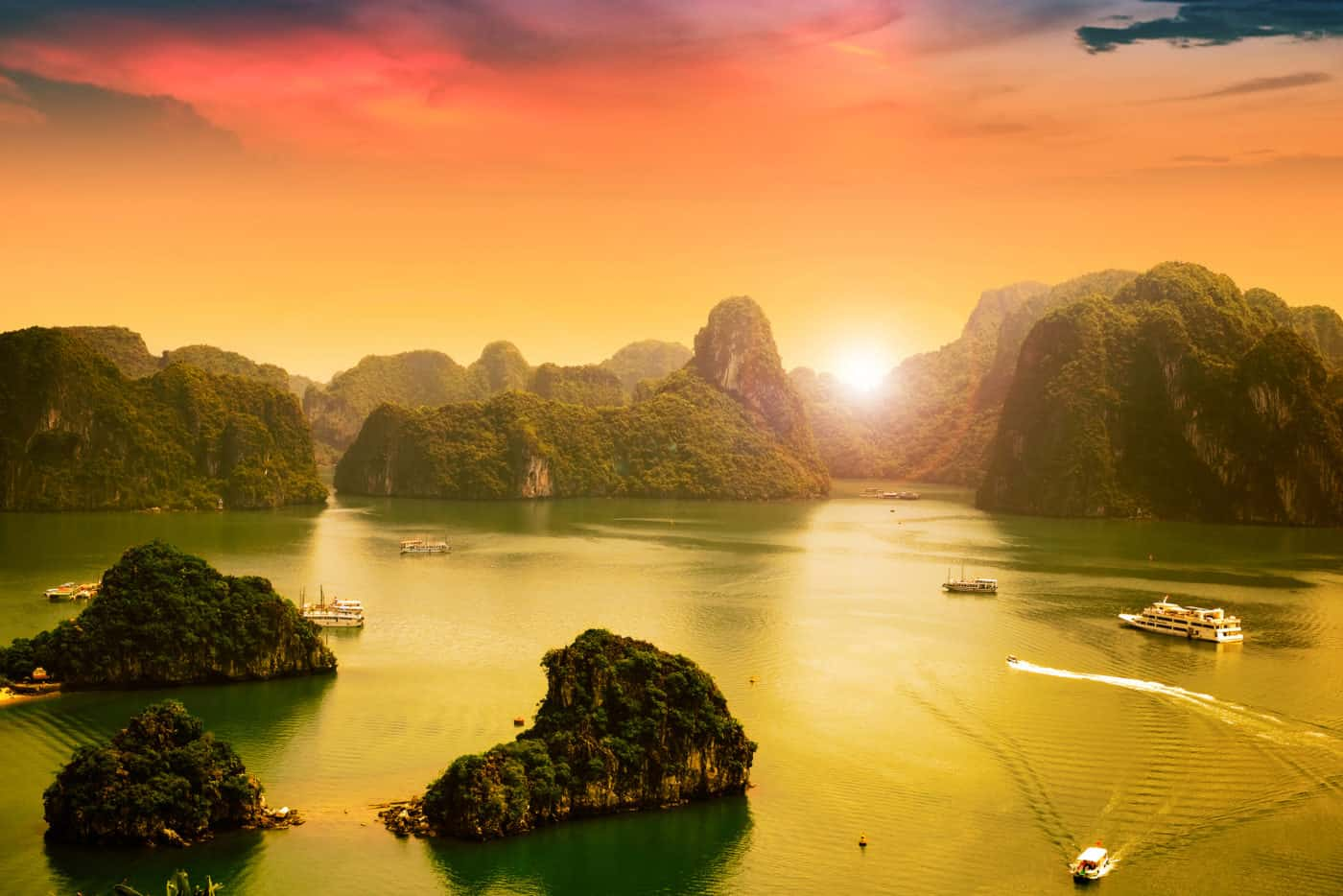 Sun setting over the mountains in Ha Long Bay
