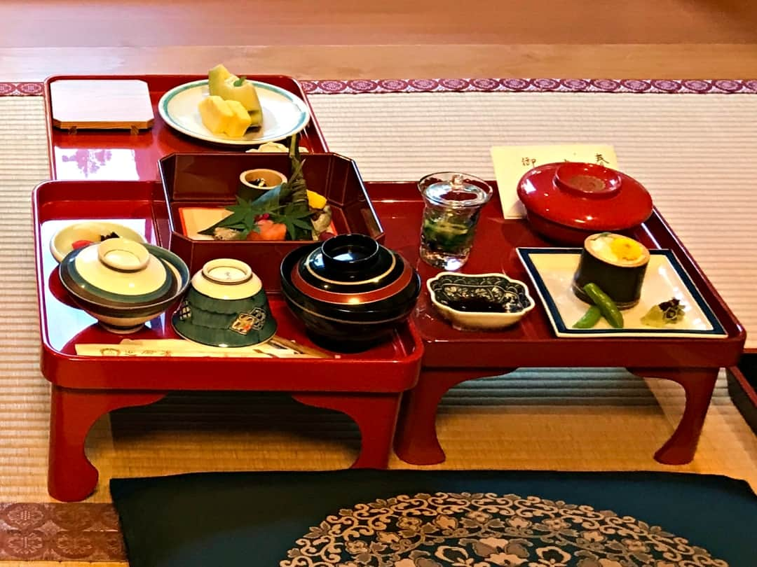 A kaiseki meal laid out on a small table in a Japanese ryokan