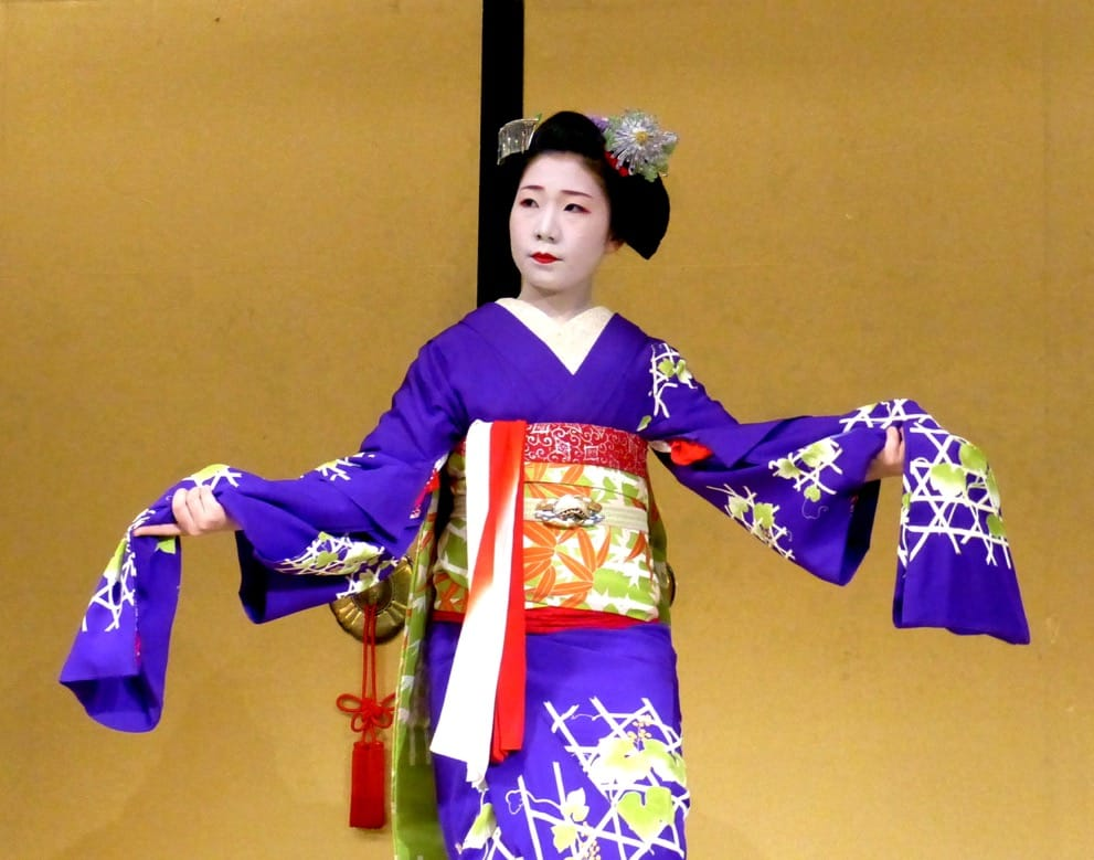 A geisha wearing a purple kimono in Kyoto