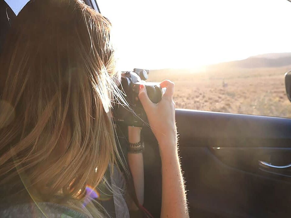 Taking safari photos from a vehicle on an African safari