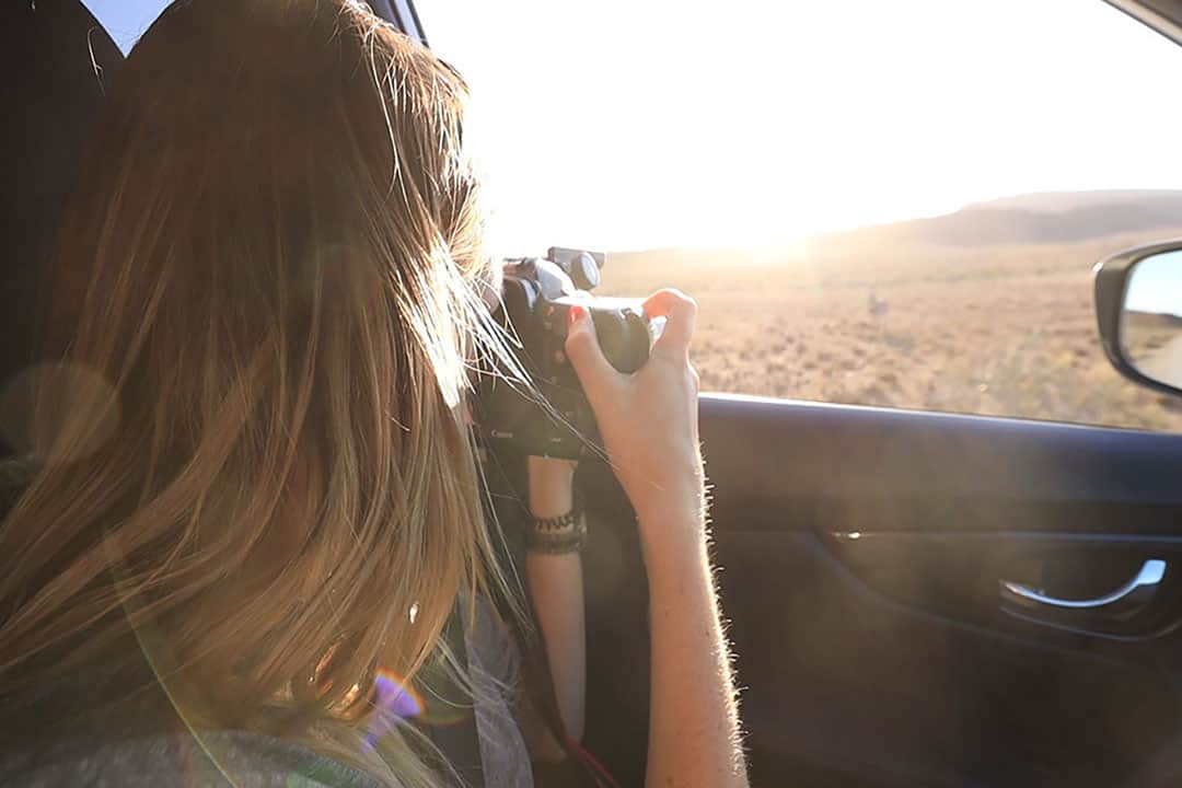 Taking safari photos from a vehicle on an African safari