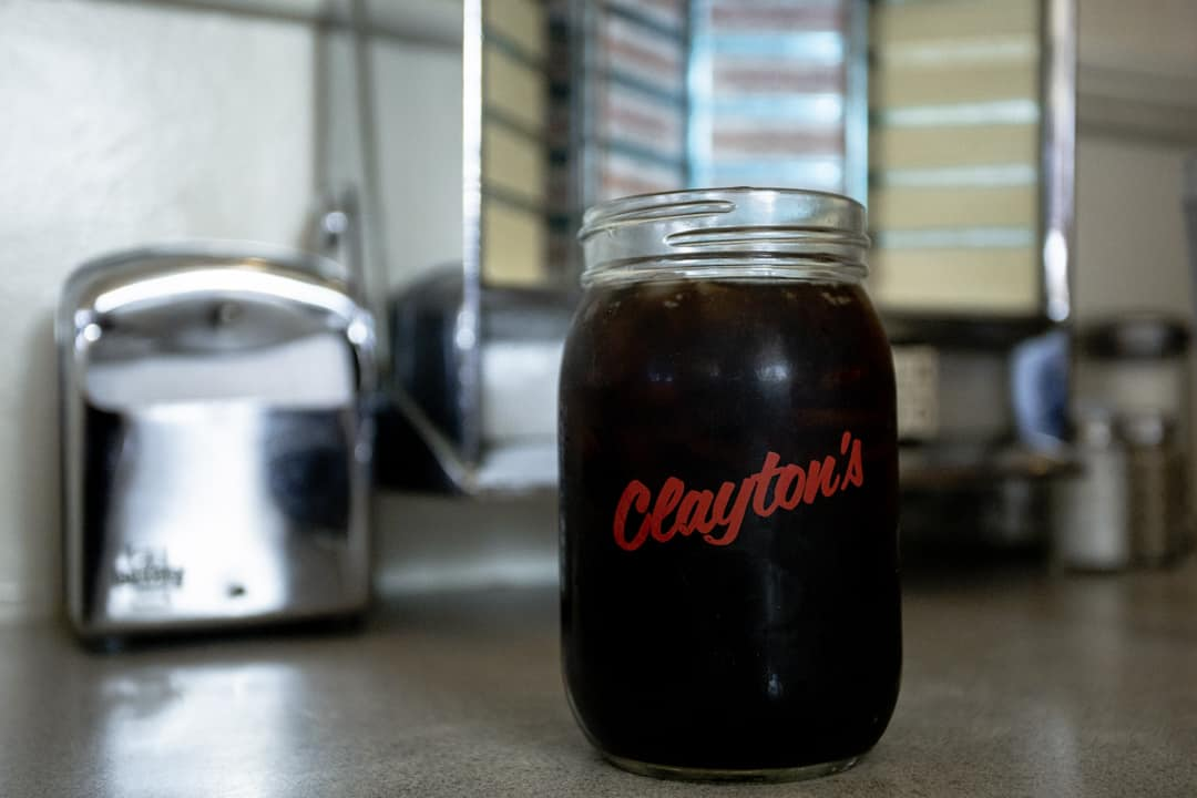 A glass of coca cola site on a diner table at Clayton's Coffee Shop in San Diego California USA