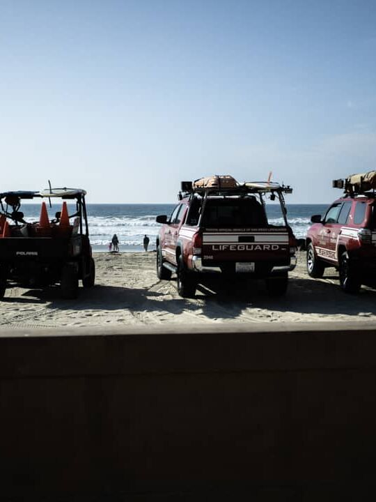 Three lifeguard vehicles on the sand in Mission Beach in San Diego California USA