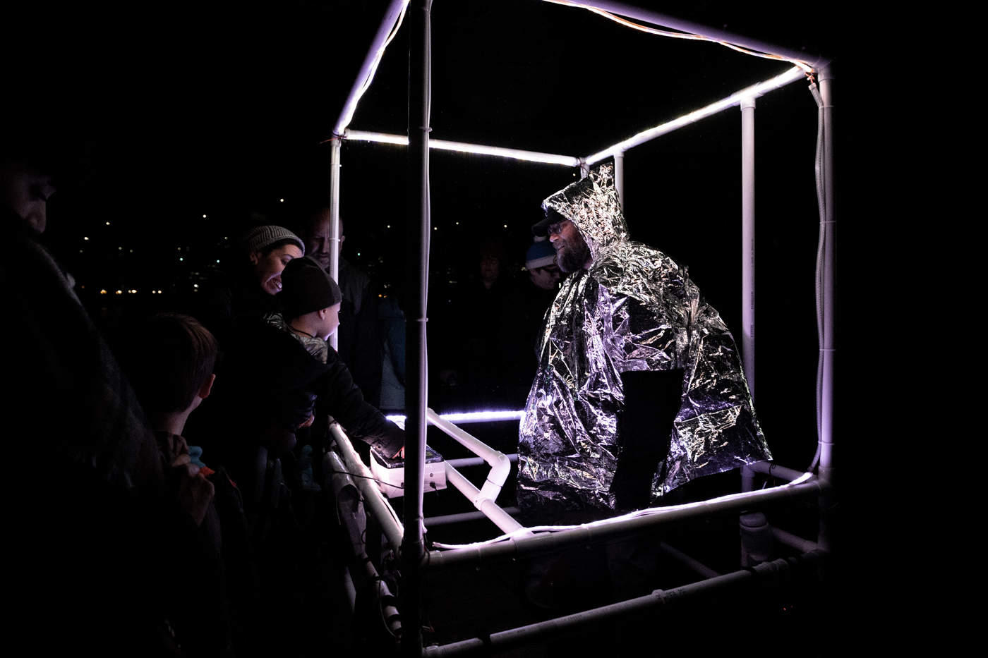 A man in an aluminium box that makes music