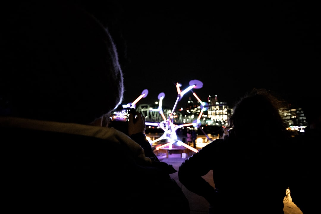 People looking at a light display at the Portland Winter Light festival