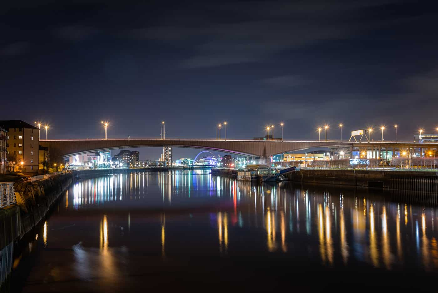 Motorway Bridge across the River Clyde in Glasgow City Centre at Night. Other Bridges Spannig the River are Visible in Background