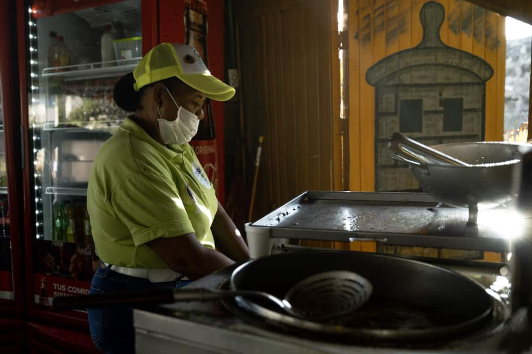A woman preparing arepas in Cartagena Colombia