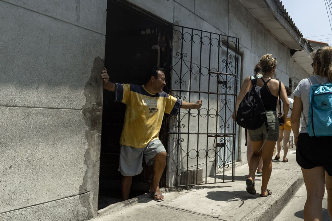 A man stepping out of his door in Cartagena Colombia