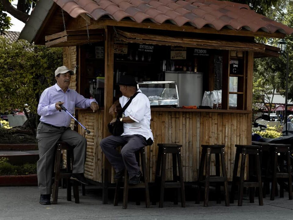 Two men chatting in the street in Filandia Colombia