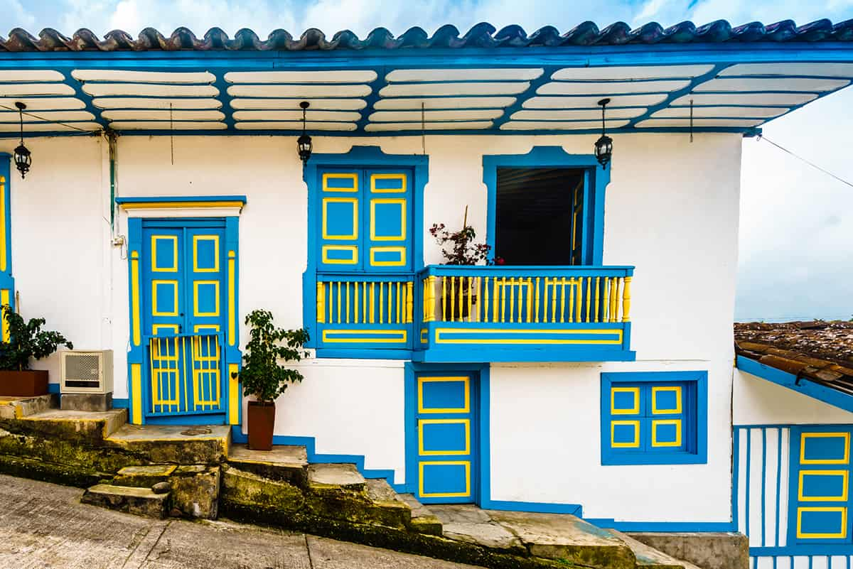 A white house with colonial style balcony in the old town of Salento Colombia