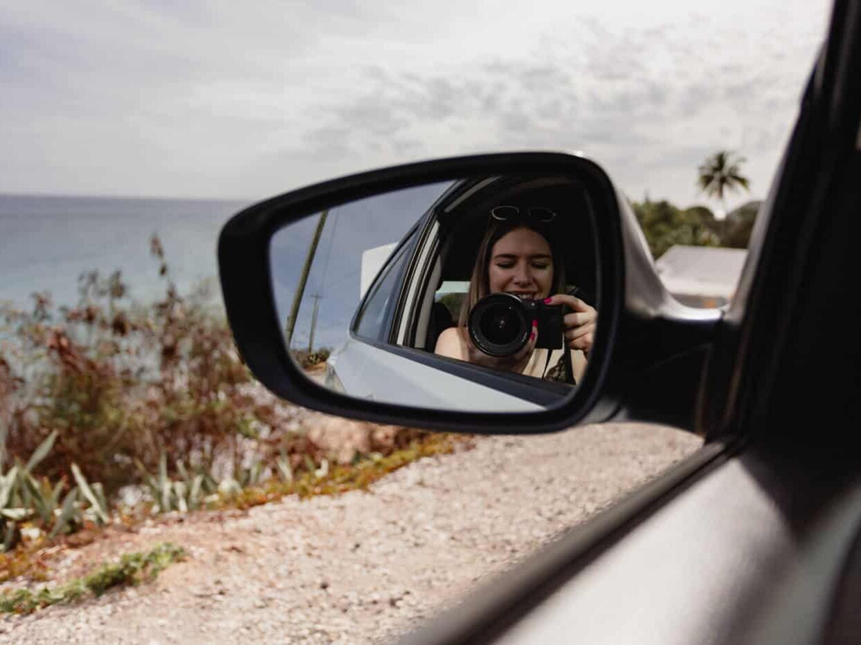 Taking photos in an Antigua rental car with my blogging camera