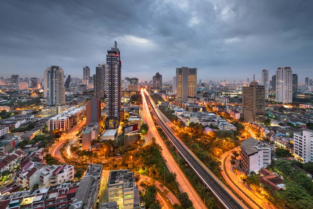 Bangkok, Thailand cityscape and highways from above at dusk.